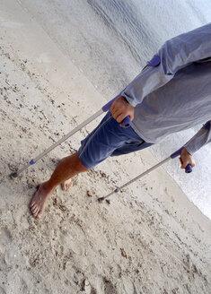 Man with crooks at beach - PE00143