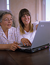 Mother and daughter in front of laptop - DK00083