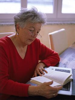 Senior woman reading book - DK00076
