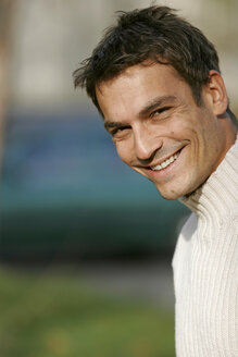 Mid adult man smiling, close-up, portrait - OW00792