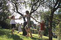 Children dancing around a tree - HH00089