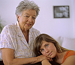 Senior woman sitting with grand daughter - DK00035