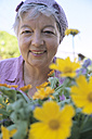 Senior woman in front of flowers, close-up - PEF00323