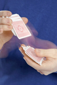 Person shuffling cards, close up - LDF00019