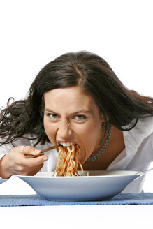 Young woman eating spaghetti - LDF00003