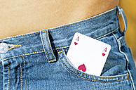Playing card in jeans pocket, close-up - ASF01267