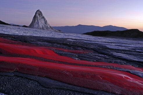 Tanzania, soda lava from Ol Doinyo Lengai volcano at dusk - RM00037