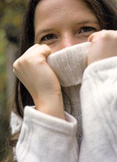 Woman wearing sweater, close-up - PE00308