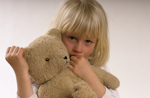 Girl (3-5) holding teddy bear, portrait - CRF00643