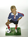 Boy (8-11) with foot on football, hand on hips - LMF00019