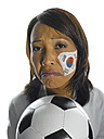 Woman with Corean Flag painted on her face, holding soccer ball, close-up, portrait - LMF00049