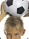 Boy (10-11)with soccer ball on head, high section, close-up - LMF00066