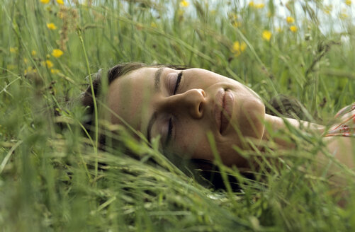 Woman lying and sleeping in meadow - LDF00078