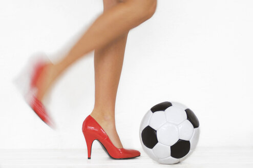 Woman with red high heels kicking a soccer ball, detail - LRF00002