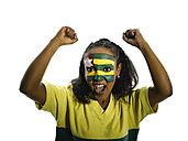 Woman with Togo flag painted on face, close-up, portrait - LMF00367