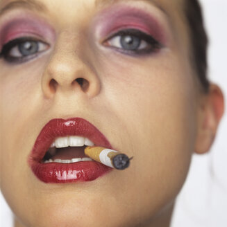 Woman with cigarette in mouth - JLF00052