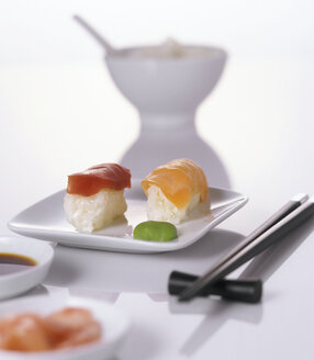 Sushi on plate with chopsticks - THF00016