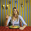 Young woman eating french fries - JLF00069