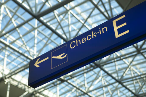 Check-in sign at airport, low angle view - THF00145