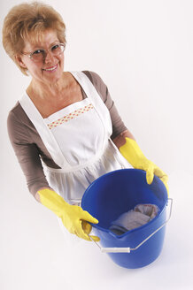 Mature woman with cleaning bucket and gloves, elevated view, portrait - 00020LRH-U