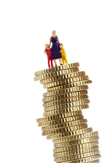 Figurines, mother and children, on pile of coins - 03134CS-U