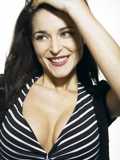 Young woman wearing striped dress, smiling - KM00033