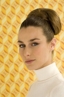 Young woman against wall paper, portrait - WESTF00339