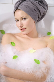 Young woman taking a bubble bath, portrait, close-up - MAEF00084
