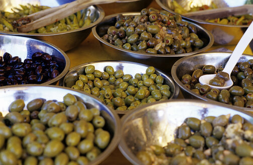 Various olives in bowls, elevated view, close-up - THF00216
