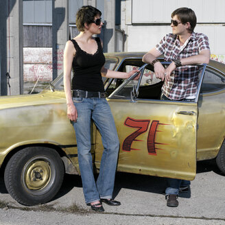 Young couple standing by car - JL00114