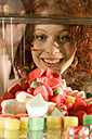 Young woman looking at sweets - CLF00120