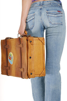 Woman carrying suitcase, mid section - 00049LR-U
