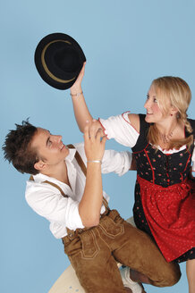 Young couple wearing Bavarian costume, elevated view - 00032LR-U