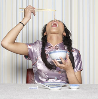 Young woman eating noodles - JL00121
