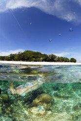 Philippines, Dalmakya Island, woman snorkelling in sea, underwater view - GNF00783