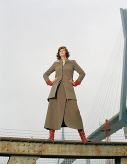 Woman standing on steel girder - DB00051