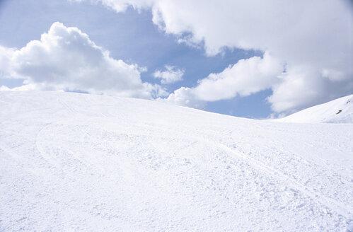 Snowy hills under cloudy sky - NHF00160