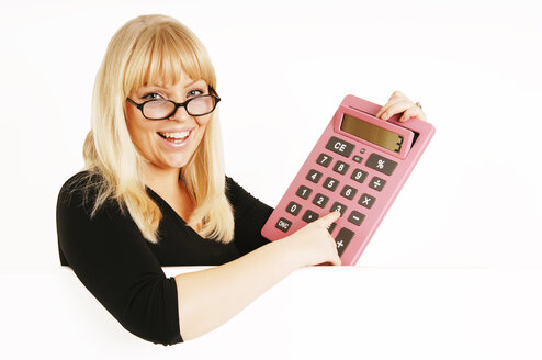 Young woman holding calculator, portrait - 00152LR-U