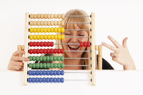Young woman holding abacus - 00146LR-U