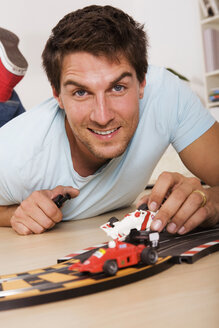 Man playing with toy cars - RDF00139
