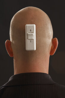 Young man with rocker switch on back of head - LD00160