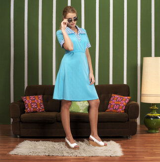 Woman in front of sofa - JL00177