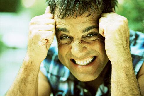 Mature man smiling, portrait - KM00307