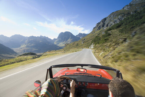 Austria, Alps, couple driving in convertible car, rear view - MSF01972