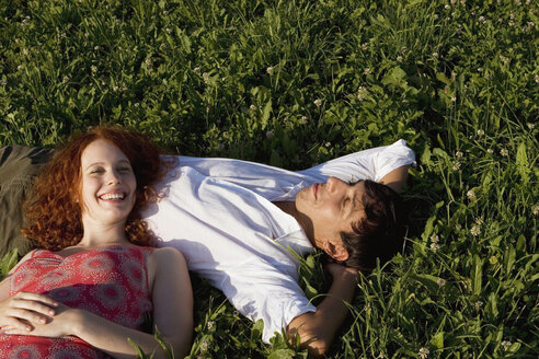 Woman lying with head on man`s belly, smiling - LDF00245