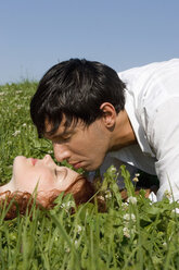 Young couple in meadow, close-up - LDF00218