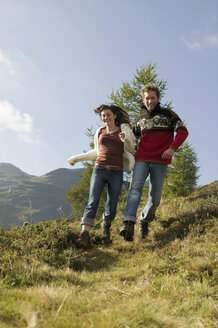 Young couple running in mountains - BABF00186