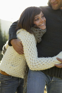 Young couple embracing, close-up - BABF00087