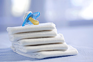 Stacked diapers, pacifier on top - SMOF00054
