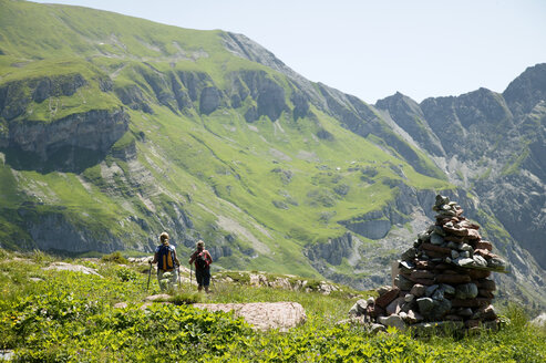 Two people hiking in mountains - MRF00656